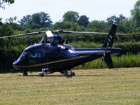 G-IFRH @ X2FF - Agusta A109C being used for ferrying race fans to Silverstone for the British Grand Prix from this temporary heliport a few miles east of Bicester - by Chris Hall