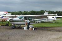 G-BFMH @ EGBD - 1973 Cessna CESSNA 177B, c/n: 177-02034 gets a wash down at Derby Eggington