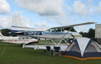 C-GFEV @ Y50 - Cessna A185F Skywagon in the grass. - by Kreg Anderson