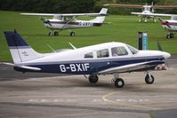 G-BXIF @ EGCB - 1976 Piper PIPER PA-28-181, c/n: 28-7690404 refuels at City of Manchester Airport