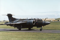 XX885 @ EGQS - Buccaneer S.2B of 12 Squadron taxying to the active runway at RAF Lossiemouth in May 1990. - by Peter Nicholson