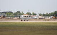 N122VK @ KAUS - Cessna departs 17L. - by Darryl Roach