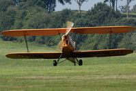 OO-WIL @ EBDT - OO-WIL comes from behind the hill. Scene on the oldtimer fly-in.