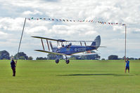 G-ECDS @ EGBK - 1943 DE HAVILLAND AIRCRAFT CO LTD DH82A TIGER MOTH C/N 86347  attempts to 'limbo' the washing line of bunting at the 2010 Sywell Airshow