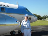 61-2490 - Brig. General James U. Cross (retired) stands with one of the JetStar he piloted for President Johnson.  The photo was made on the LBJ Ranch taxiway with Texas White House in background. - by Russ Whitlock