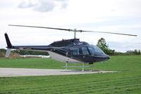 G-LBDC @ EGTB - Bell 206B Ex N206GF at Wycombe Air Park - by moxy