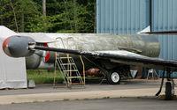 56-0901 @ KBDL - The NEAM Starfighter awaits its turn to full restoration. - by Daniel L. Berek