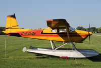 CF-IUB @ CNJ4 - Brightly colored Cessna 185 on floats - by Duncan Kirk