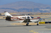 N1380J @ KCCR - Locally-based 1975 Rockwell Intl 112A taxis for take-off at Buchanan Field - by Steve Nation
