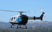 N8118Y @ KCCR - CALSTAR 1989 BO105LS landing at Buchanan Field - by Steve Nation