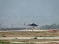 N411MB @ CNO - Flying touch & go's runway 26L - by Helicopterfriend