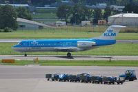 PH-KZH @ EHAM - Yet another KLM cityhopper taxiing for departure - by Robert Kearney