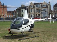 G-CBWZ - Robinson R22 Beta at the 2010 Helidays on the Weston-super-Mare seafront