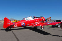 CF-WLO @ KRTS - Race #64 is a CCF Harvard Mk. IV in Royal Canadian Air Force Red Knights colors being towed to active ramp for T-6 Class racing @ 2009 Reno Air Races - by Steve Nation