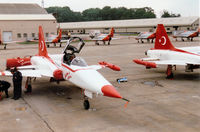 3027 @ EGVA - NF-5A Freedom Fighter of the Turkish Stars aerobatic display team on the flight line at the 1997 Intnl Air Tattoo at RAF Fairford. - by Peter Nicholson