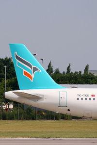 TC-TCE @ EGCC - Turkuaz Airlines - by Chris Hall