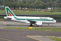 I-BIML @ EHAM - Alitalia taxiing for departure - by Robert Kearney