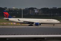 N803NW @ EHAM - DAL taxiing out for departure - by Robert Kearney