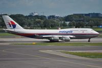 9M-MPK @ EHAM - Malaysia taxiing for departure - by Robert Kearney
