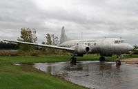 N114BF @ KOSH - Bereft of its engines, this rare Convairliner sits in a puddle at the Balser compound at Oshkosh. - by Daniel L. Berek
