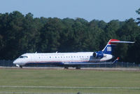 N720PS @ KMYR - 2004 Bombardier CL-600-2C10 waiting to take off in Myrtle Beach as the heat rises.. - by Richard T Davis