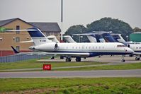 M-JSMN @ EGGW - 2006 Bombardier BD-700-1A11, c/n: 9216 at Luton - by Terry Fletcher
