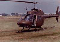 71-20527 - OH-58A that flew with Hq & Hq Company, 372nd Engineer Group 9USAR) at Fort Des Moines, Iowa in the 1980s.  I am at the controls with the red stripes on the visor of my flight helmet.  Was reregistered as N1045C in NOV of 2002. - by Bookie