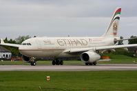 A6-EYH @ EGCC - Etihad Airways - by Chris Hall