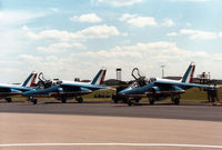 E156 @ MHZ - Alpha Jet number 9 of the Patrouille de France aerobatic display team, alongside E173 number 1, on the flight-line at the 1988 RAF Mildenhall Air Fete. - by Peter Nicholson