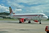 9M-AFJ @ WBKK - Air Asia Special Livery A320 at Kota Kinabalu - by Terry Fletcher