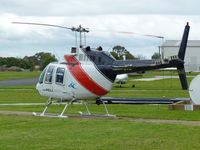 VH-JRE @ YMMB - Bell 206B at Moorabbin.