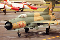 5822 @ EGVA - MiG-21 Fishbed of the Sky Hussars, the Hungarian Air Force display team, taxying to the active runway at the 1993 Intnl Air Tattoo at RAF Fairford. - by Peter Nicholson