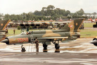 5540 @ EGVA - MiG-21 Fishbed of the Sky Hussars Hungarian Air Force display team on the flight-line at the 1993 Intnl Air Tattoo at RAF Fairford. - by Peter Nicholson