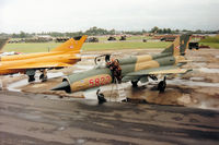 5822 @ EGVA - MiG-21 Fishbed of the Sky Hussars display team on the flight-line at the 1993 Intnl Air Tattoo at RAF Fairford. - by Peter Nicholson