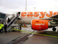 G-EZAW @ EHAM - disembarking from EZAW after our flight from EGGP - by Chris Hall