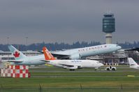 C-GNAU @ YVR - Being towed to the parking area - by metricbolt