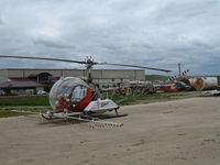 N1310X @ KKIC - Soilserv 1966 Bell 47G-5 sprayer in non-standard red cs @ Mesa Del Rey Airport, King City, CA - by Steve Nation