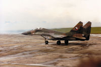 9207 @ EGVA - Czech Air Force MiG-29A Fulcrum preparing to join the active runway at the 1993 Intnl Air Tattoo at RAF Fairford. The visible spray will remind all those who were there of the weather conditions. - by Peter Nicholson