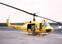N6132Z @ KSUT - Bell UH-1H of the NC Forest Service at Brunswick County airport, Oak Island NC