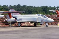 153088 @ KNPA - A bit fuzzy, photographed from a moving bus.  Shot down a MiG-17 on 6/11/72.  Displayed here at the National Museum of Naval Aviation before being repainted and sent to New York - by Glenn E. Chatfield
