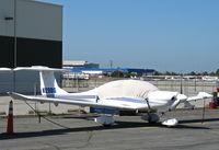 N129DG @ KSQL - Locally-based 2002 Diamond DA-40 with cockpit cover @ San Carlos, CA - by Steve Nation
