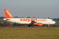 G-EZTE @ EGGW - easyJet A320 taxying to RW26 - by Chris Hall