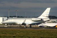 VP-BRA @ EGGW - Falcon 2000 landing on RW26 - by Chris Hall