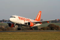 G-EZAW @ EGGW - easyJet A319 landing on RW26 - by Chris Hall