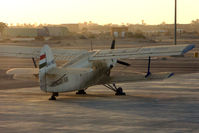 HA-MBG @ HELX - Surprise to find this AN-2R on the Luxor Ramp - photo through plane window whilst taxying in