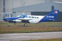 G-NOSE @ EGNX - 1975 Cessna CESSNA 402B, c/n: 402B-0823 at East Midlands
