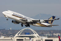9V-SPN @ LAX - Singapore Airlines 9V-SPN (FLT SIA11) climbing out from RWY 25R en route to Narita Intl (RJAA). Now with large titles. - by Dean Heald