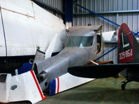G-BSWH @ EGBD - stored in the corner of the main hangar - by Chris Hall