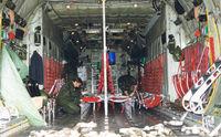 84007 - Swedish Air Force .Preparing cabin for pax transport.  C-130H Hercules . Angelholm F10 base, Jul '99 - by Henk Geerlings