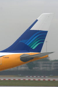 G-SMAN @ EGCC - still wearing Garuda Indonesia colours on the tail after returning from lease - by Chris Hall